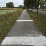 Verwijderen van oneffenheden in betonfietspaden.